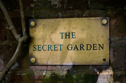 Brass sign at entrance to the Secret Garden, Groombridge Place, England